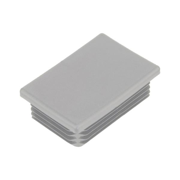 Žebrovaná obdélníková plastová zátka - plochá 60x40 mm, žebrování 1-3 mm, šedá erodovaná